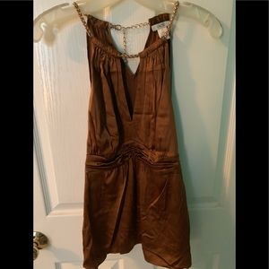 Brown silk top with gold accent chain.